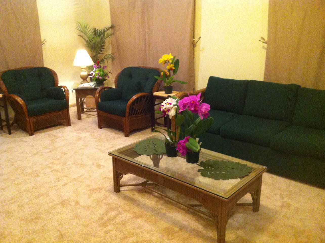 Living room with sofa, reading chairs.  Fresh flowers greats all guests.