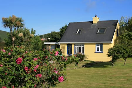 This cozy, Irish cottage sits on the hillside overlooking Ventry Bay, which is a small bay off of Dingle Bay on the southwest coast of Ireland.  Surrounded by sheep and cows, it offers beautiful views of the ocean and the mountains.