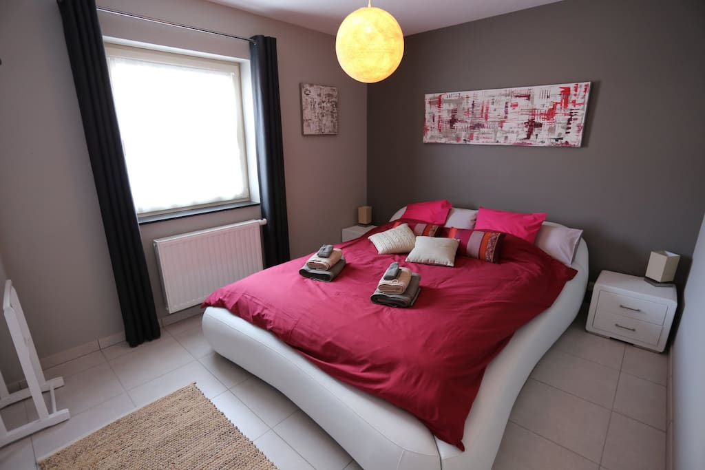 first room with queen bed