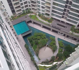 """Clean and cozy studio apartment in Kuala Lumpur City Center, Complete with kitchen, dining table, king size bed, 32"""" LED TV able to play movie via USB, bathroom with rain shower, parking lot, Internet, washing machine and accommodate extra guest."""