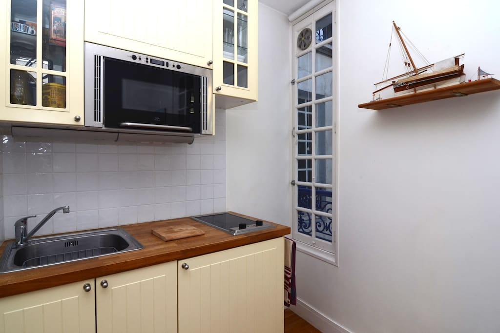 Kitchen space has nice natural lighting and great utensils as if you were at home, and looks over courtyard.