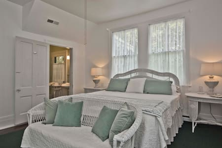 The Lily Room is a light and bright bedroom with a full en suite bathroom on the second floor of a National Historic Register listed c. 1888 historic home - B & B in the charming village of Flat Rock.
