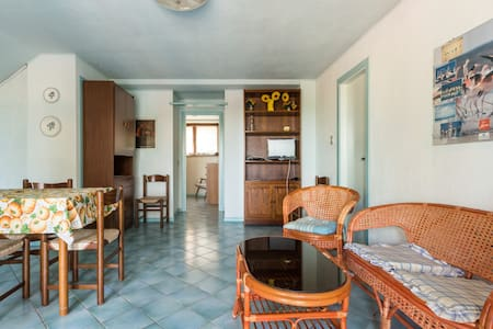 Located in one of the most beautiful and unspoiled parts of Sardinia, this house offers everything for a perfect vacation by the sea. The house opens literally on the beach facing a calm natural bay with small fishing boats.