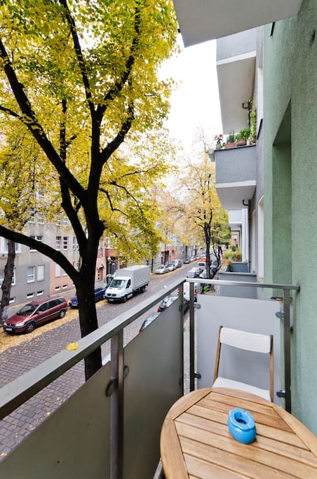 Comfortable balcony with table and chairs for eating and drinking
