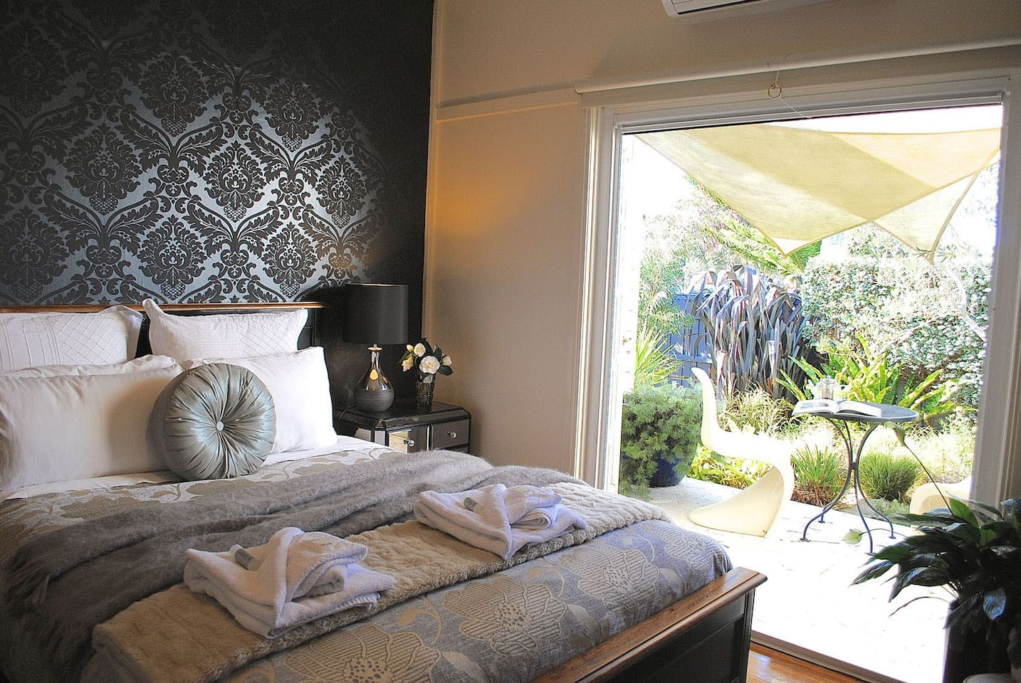 Main bedroom- luxury queen mattress- fine linen- french doors- garden deck