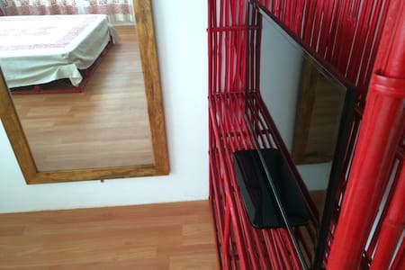 """Retro Red is our blue-color themed boutique apartment (studio) fully furnished with all basic amenities like TV (32"""" LED), Stand-fan, WC, Wifi, Kitchenette, fridge, microwave oven, cookwares, customised flatwares and ceramic dinnerwares."""