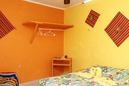 An economy room, with private bathroom for people traveling on a budget.    Enjoy all the comforts of our beautiful casa which is just 150 meters from the beach.