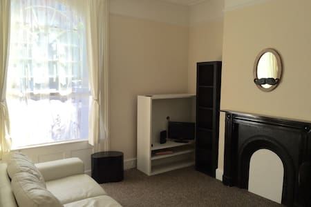 High ceilings throughout is our spacious 1 bedroom ground floor apartment. Direct access to communal garden and Private car park. 5 mins walk to the city centre. In the building there's an extra laundry room with washer and dryer. Fresh bed linen, towels will always be in the apartment.