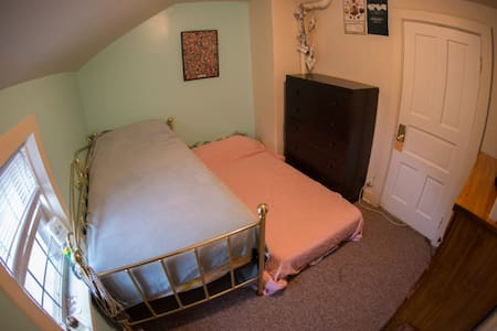 Small and simple, this is a plain bedroom with two twin mattresses. Perfect if just looking for a room to spend a night or two, a couple days, or extended time. You would be sharing the house with me and my wife.