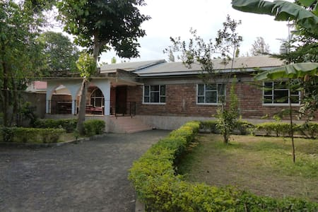 Although we are close to the city centre we live in a quite neighborhood which welcomes you to relax. We have a big garden and two wonderful dogs who always love to be petted. We have a big living room where we can hang out together.  Karibu sana!