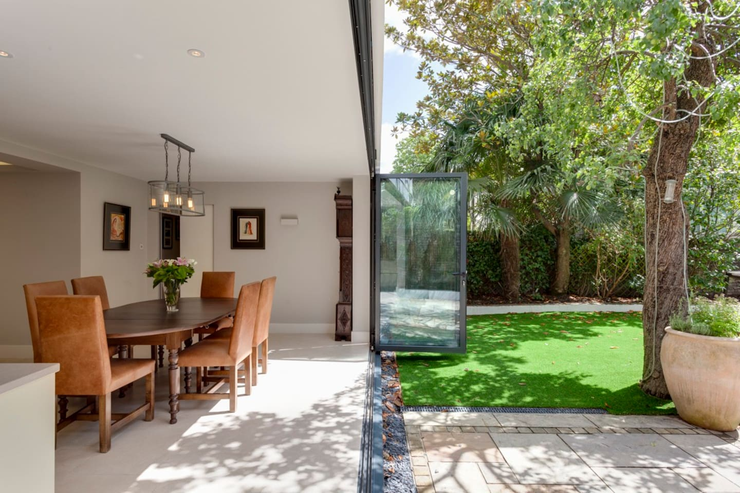 Bi-folding doors fully opened to allow the flat to extend into the garden