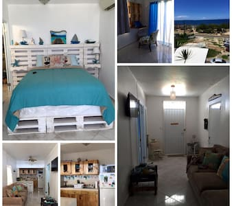 Right in front of the beach.Two minute walk to bars,beach and  restaurants . Two bedroom home ,master bedroom has a queen size bed private balcony and A/C. Full kitchen /living room /terrace.New Home rustic style home with the luxury of paradise.