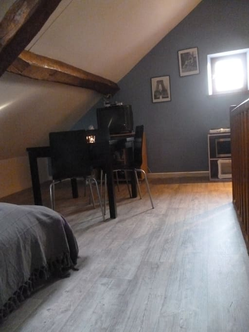 your second room upstairs with table, kitchen, double bed, bathroom, toilets