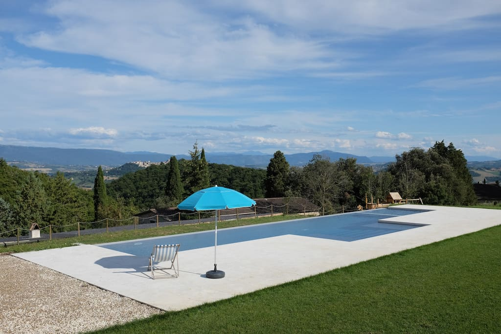 Our infinity pool with hidro massage corner and benches within the water