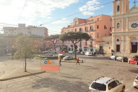 The room is a loft located in an historcal building in the real center of Portici, just 5 min walking form the beach and the ancient port of Granatello, on the side of a very typical fresh food street market, 10 min walking from train station.