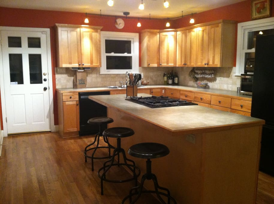 Large eat-in kitchen at night.