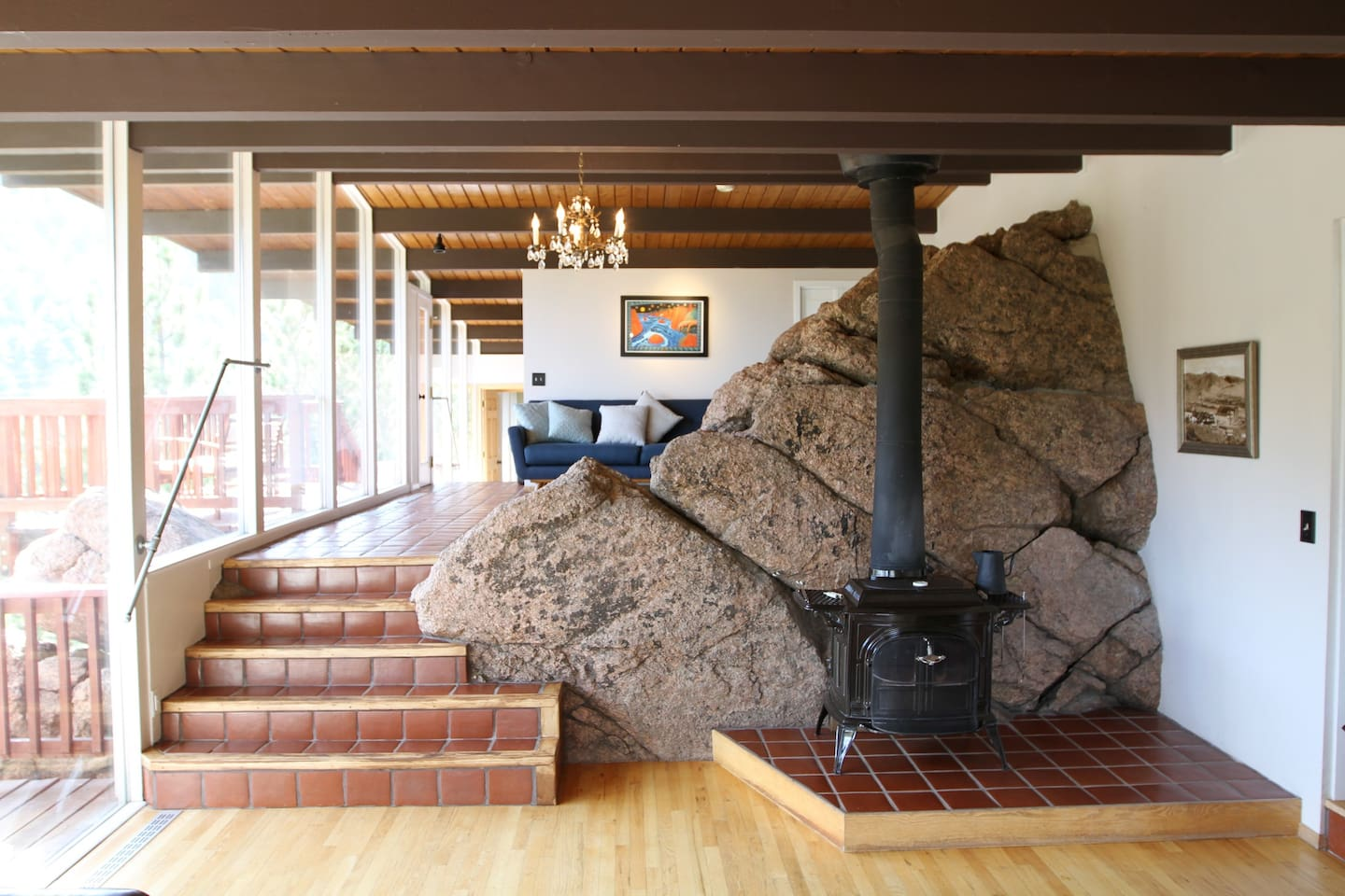 A rock flows through this house which is a copy of a Frank Lloyd Wright (making this a Frank Lloyd Wrong).