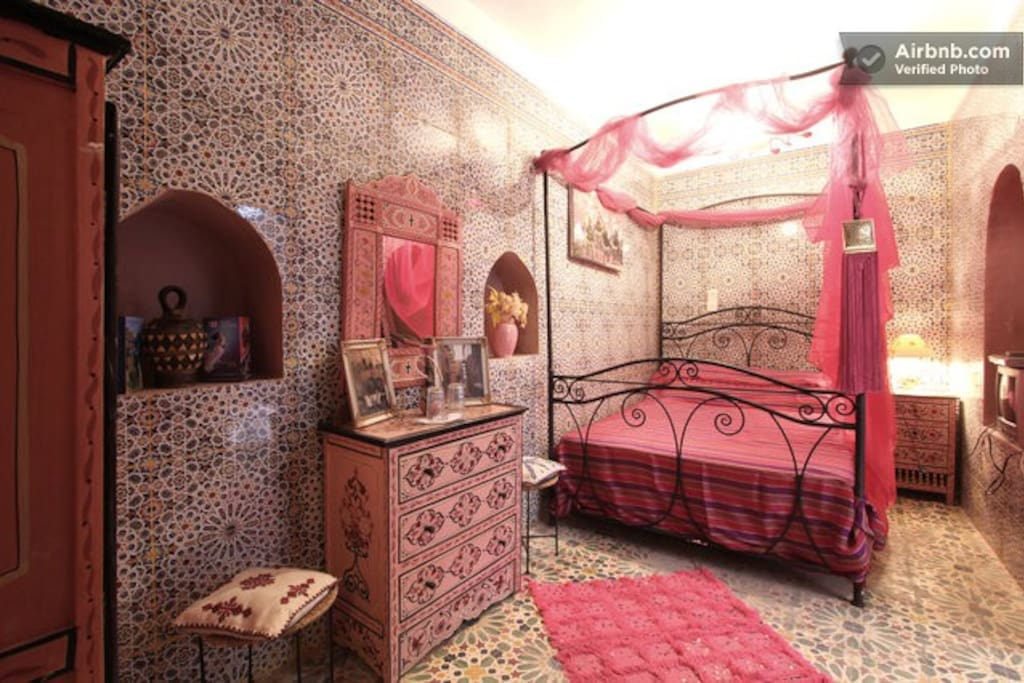 The pink room is the only bedroom at the bottom floor and it has a private bathroom.