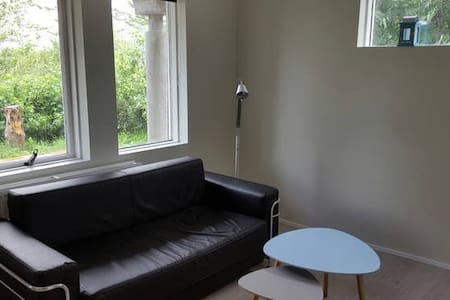 New 50m² apartment .The apartment is exclusively used for travelers and not lived in. Location is 15 min drive from Reykjavik center and 20 min to Þingvellir national park. A private veranda with spectacular ocean view and Northern light sightings.