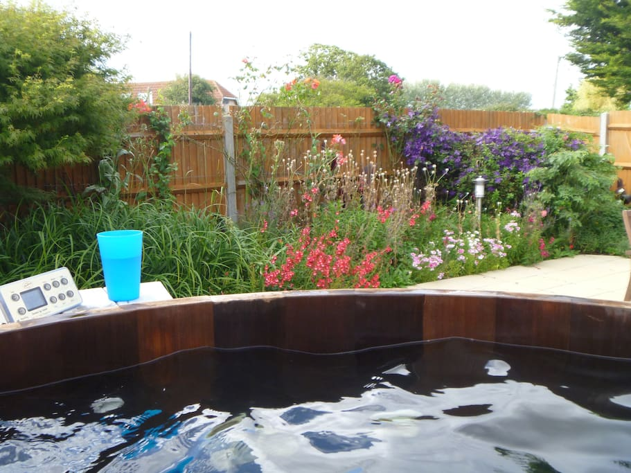 View from the hopt tub of the patio garden in Summer.