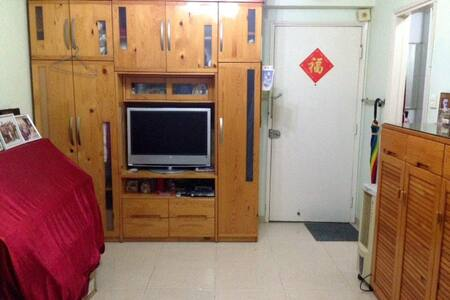 "Only rent till 23/9, our house is located in Hung Hom ""food street"". The private room has a single bed with a small TV (wardrobe is full..). You can enjoy the living area, kitchen and bathroom. Free wifi. Speaks great Eng, Mandarin & Caontonese."