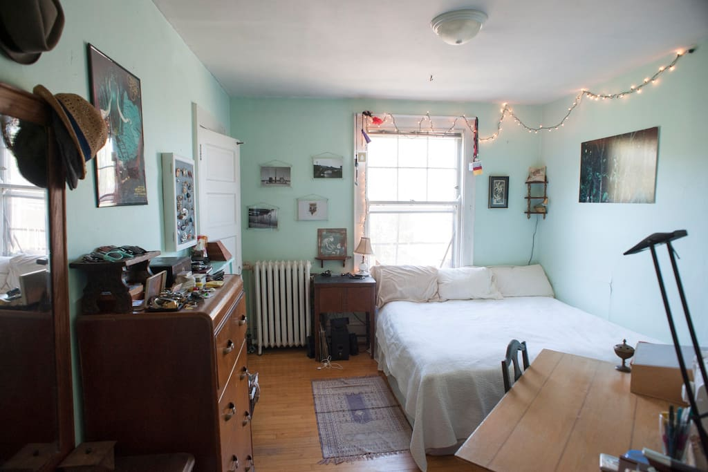 Bedroom 1: Features a queen size lofted bed and a futon that can be turned into a second queen size bed. Features a closet with space available for guests and a desk for working.