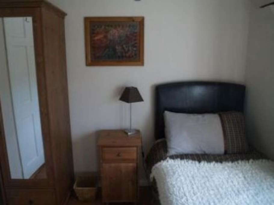 Single room with two spacious drawers under bed, single wardrobe, blanket box, locker and three deep storage drawers