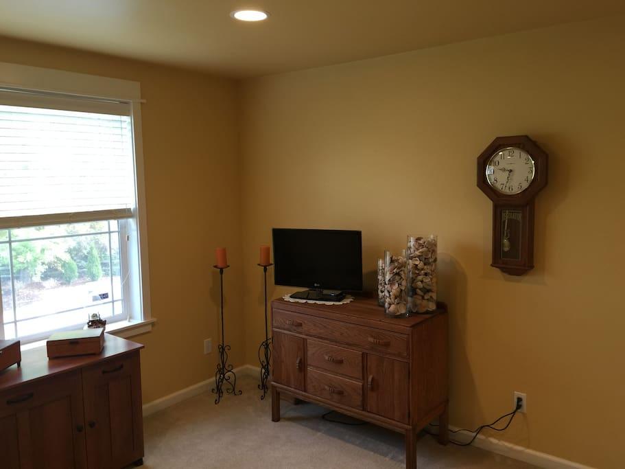 Bonus Room TV and vintage chiffonier for personal storage.
