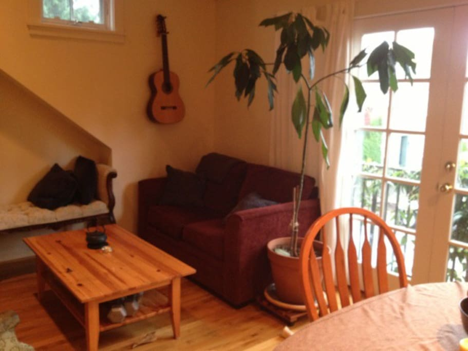 Living room area (We've rearranged a bit since this was taken to improve the space, but it looks more or less the same; there is also now a ukulele in addition to a guitar.)