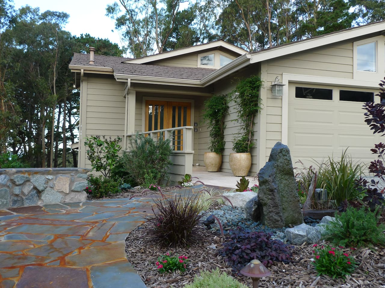 Front entryway garden with fountain welcome guests and  encourage plenty of birds to entertain you.