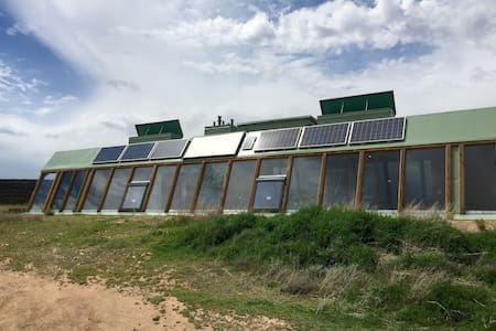 Stunning Off-The-Grid Earthship - House