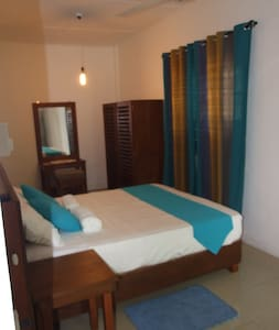 Situated in a highly residential area, 1.5 km to the  City Center.  Surrounded by nature, with tall trees.  The room has a queen size bed attached toilet with hot water shower.  You will love the tranquil atmosphere.  Walking distance to the city.