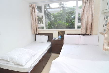 This is ensuite room with private bathroom  Good for 3 people with 2 beds  Key area: can reach 3 MTR stations in 5 mins: Kowloon, Jordan & Austin