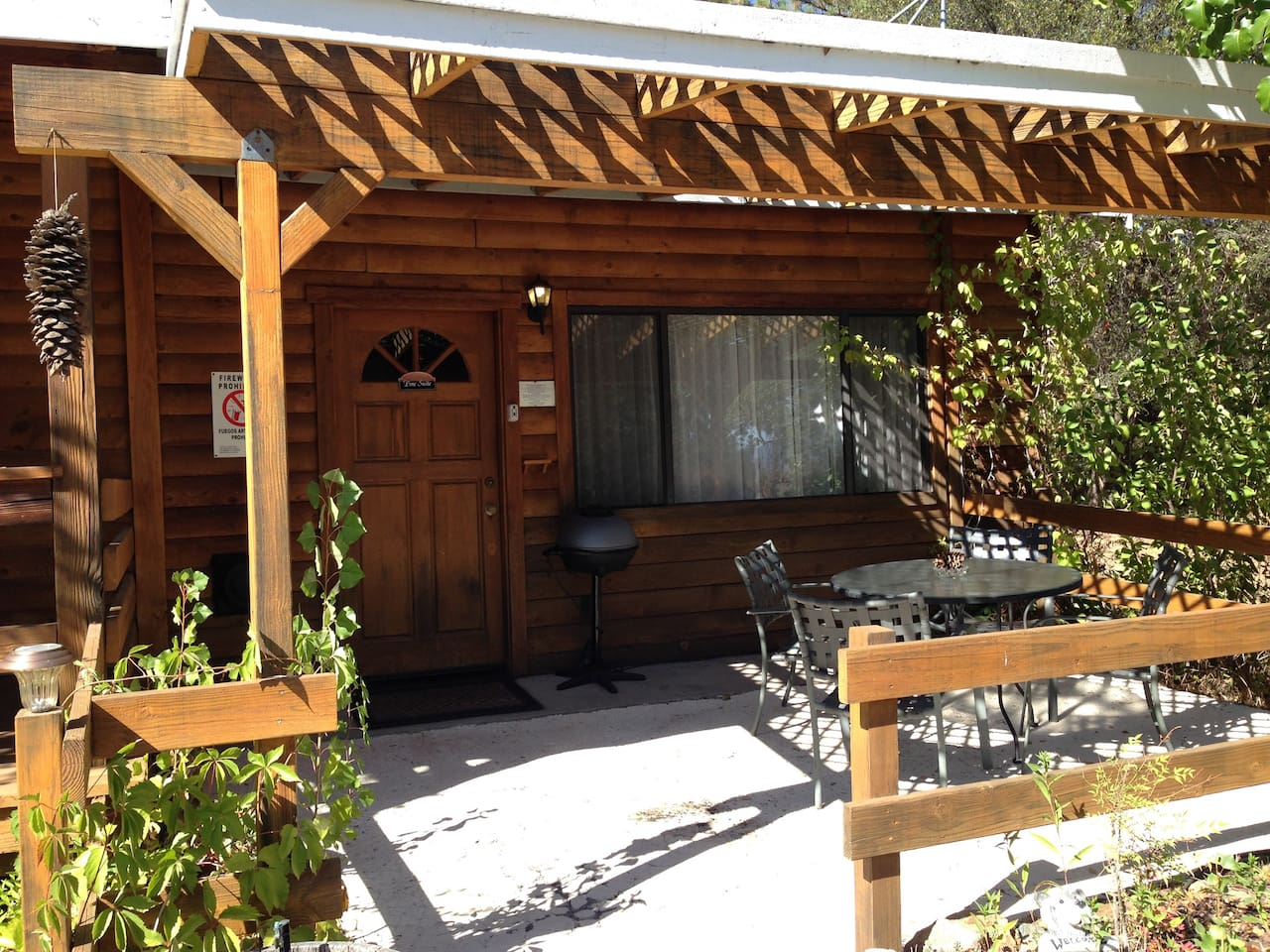 Pine Suite is a single story studio with two queen beds, private patio & electric BBQ