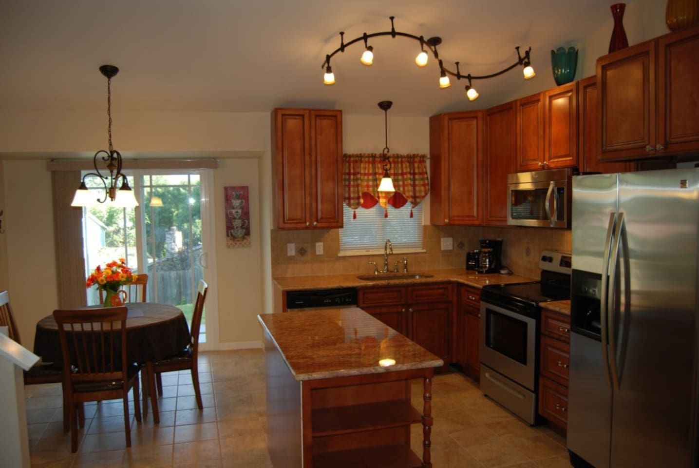 Beautiful kitchen with granite counters and stainless steel appliances