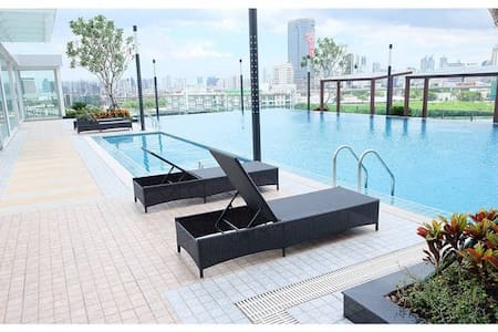 Brand new room 2014 The Condo (with kitchen,washer, gym, swimming pool & FREE WIFI). Located in center only 7 mins walking to MRT Rama 9 and 1 station to airport link,very convenient for your travel in BKK.  Close to Central rama9 to eat & shopping.