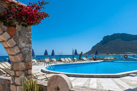 The sea view Studio in Blue Beach Apartments is next to the sandy beach, in the quiet, seaside village of Stavros in Akrotiri Peninsula, 15 km north east of Chania.
