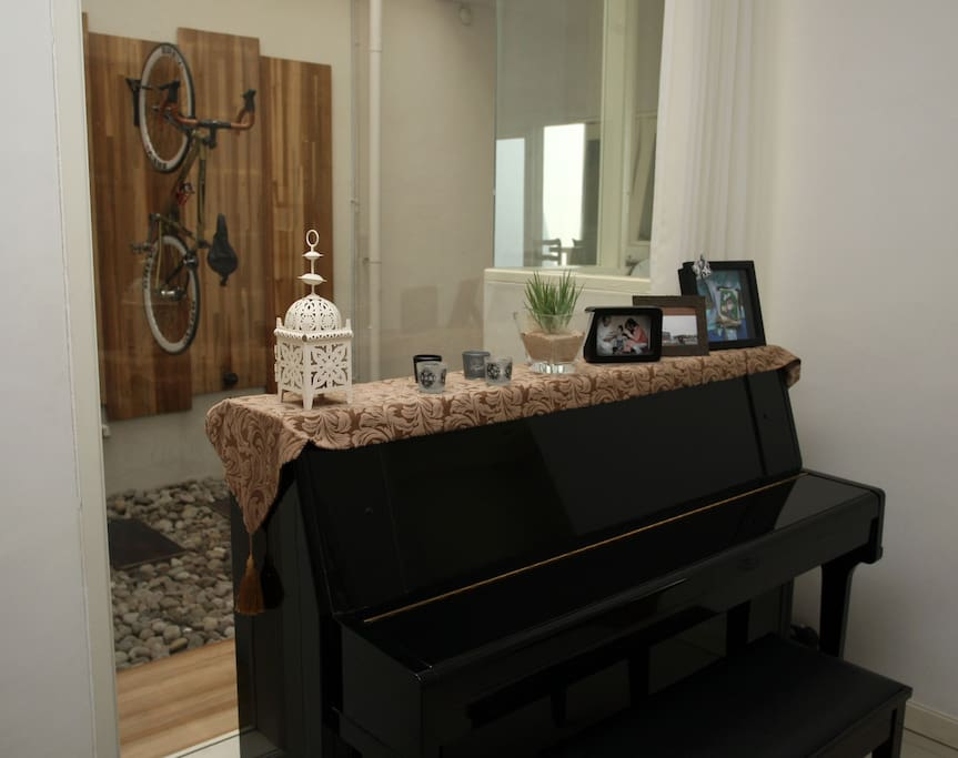piano with bike wall view. the guest is welcome to play the piano. we love the piano sounds in our house.