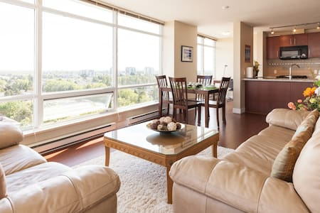 Tastefully decorated high rise apartment on 15th floor . 1050 Sf and open kitchen , open den with a view of green area and Mt. Baker . Close to transit and shopping mall . North-East facing with big window ; enjoy the 180 degrees panoramic view.