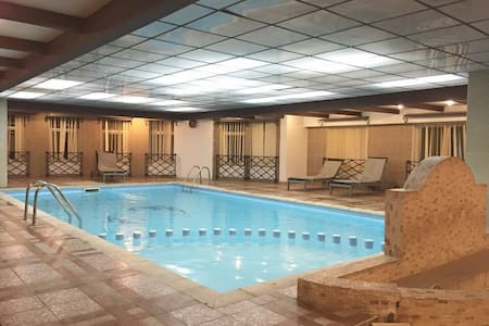 Private Room with Gym/Pool in Doha