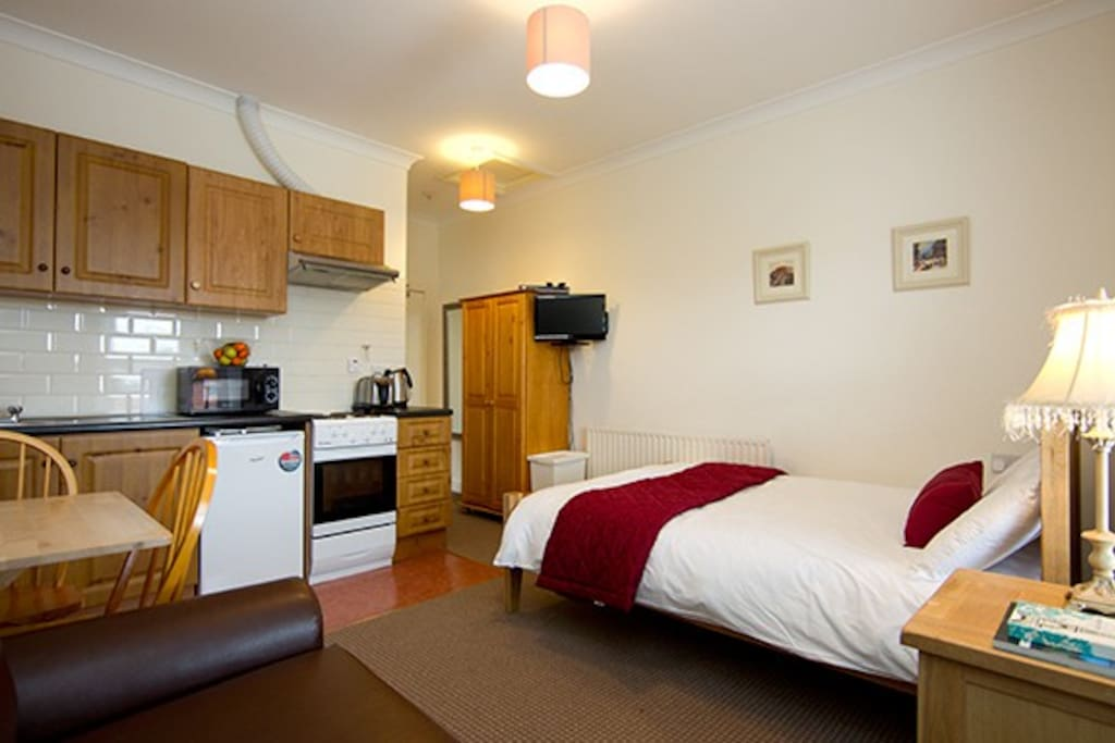 Double bed & kitchen area