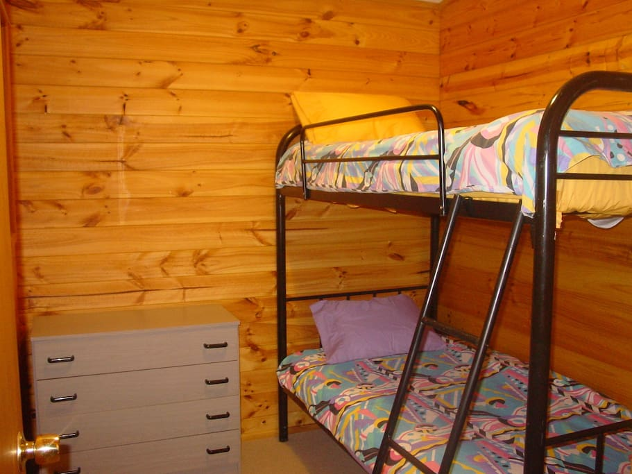 The bunkroom provides bedding for two others of a family group. Part of the King Suite of three rooms.