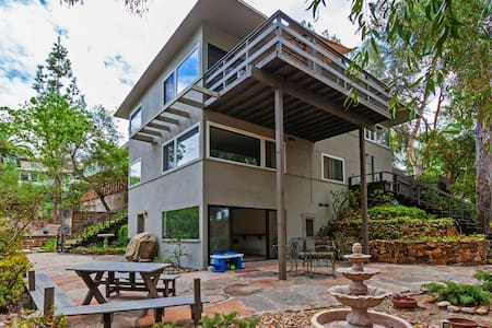 This is such a rare home!  Tucked away on a quiet, tree lined street with views of the beautiful canyon, and tons of secluded outdoor space.  Mid Century Modern furnishings, wood floors & high end appliances.  Perfect quiet retreat after a busy day!