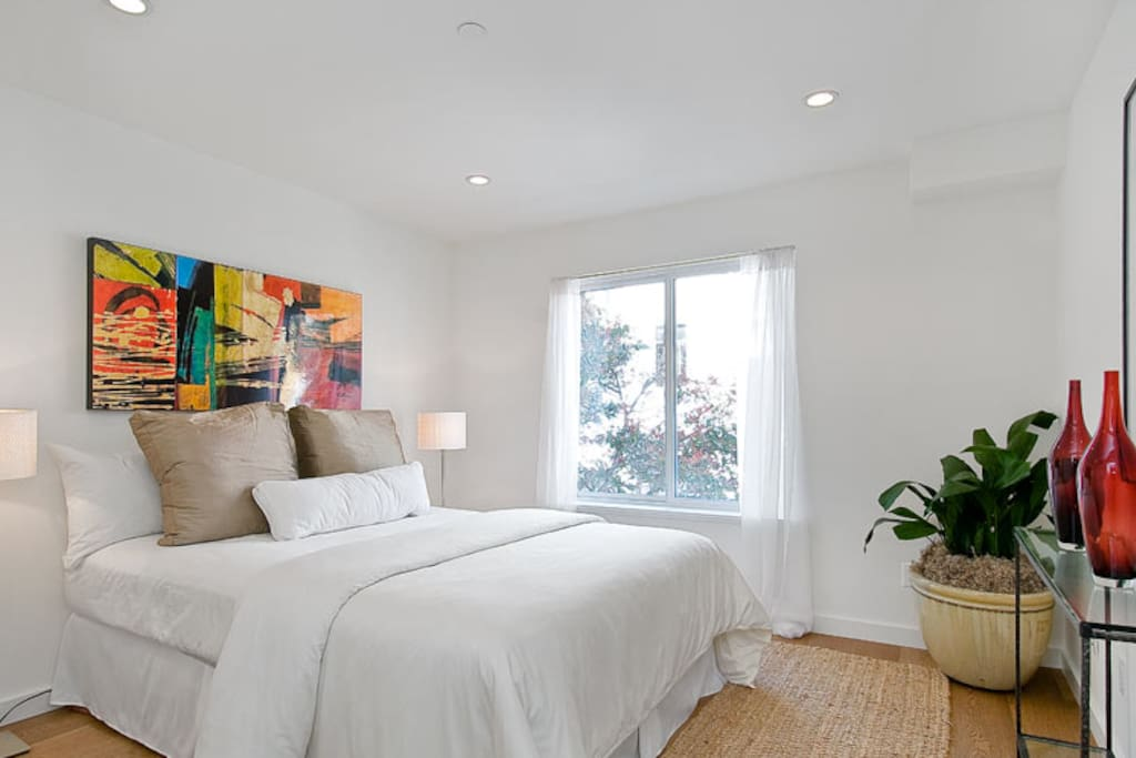 Welcome to your bright and comfy guest bedroom! Equipped with recessed lighting, plenty of closet space, a flat screen TV (not shown), and a plush and comfy Queen-sized bed!