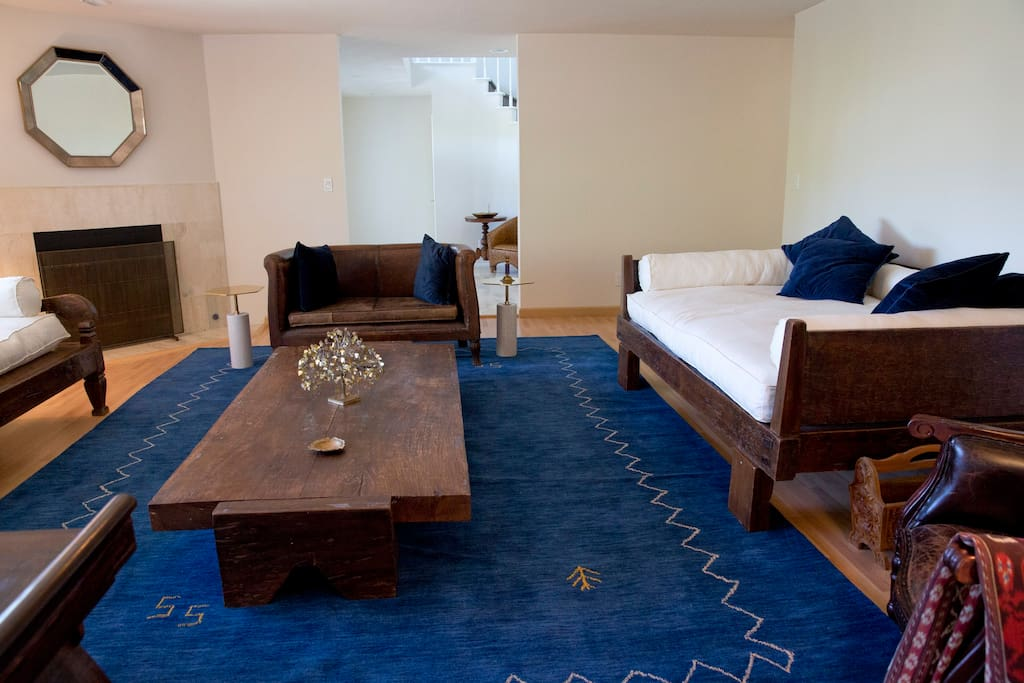 Klein blue rug, with stunning antique furniture and bronze accents