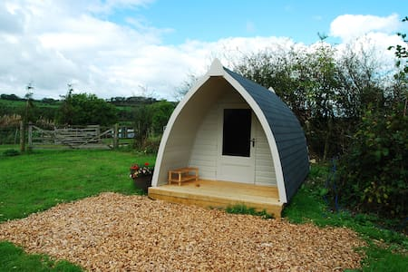 Our beautiful camping pod sleeps 2 adults comfortably but could sleep 3 adults or 2 plus 2 young children. Based on our working farm with panoramic views of local fells and Skiddaw.  Birdwatching tarn and Hide opposite. electric points and lights