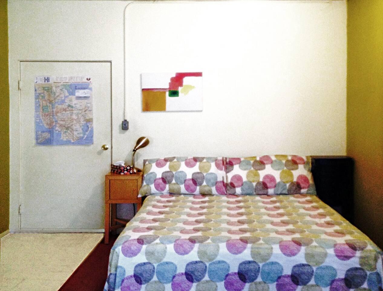 ROOM:  Queen size bed.  View towards door from windows in room.