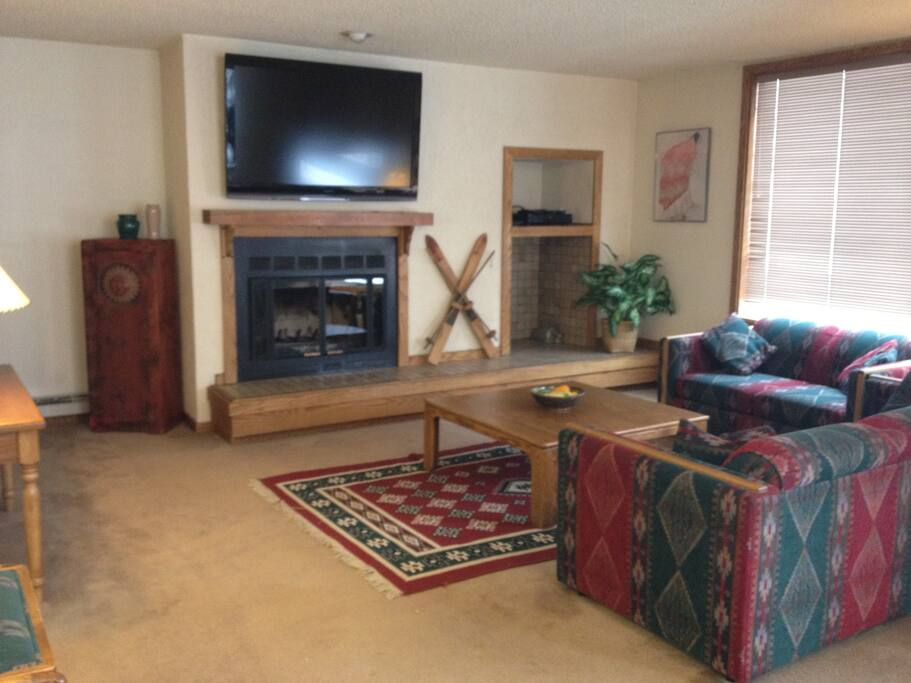 Great Room with wood-burning fireplace and flatscreen HDTV.