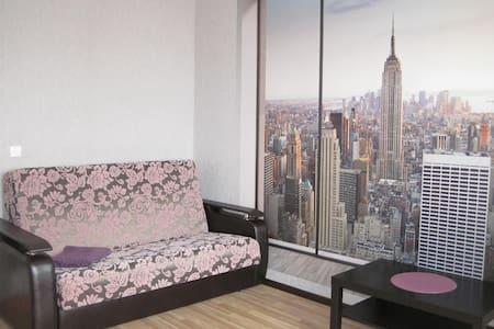 Современная, стильная квартира с прекрасным видом. - Leilighet