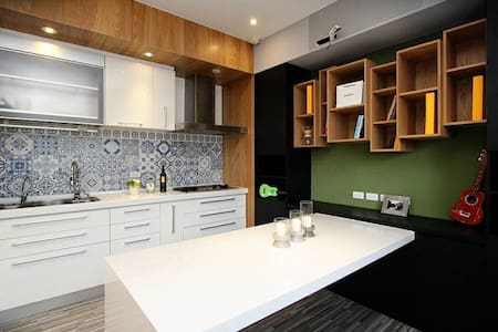 Our apartment is perfect for a group of friends or family. It is also the best choice for business purpose guests. The apartment is located in a new building with 24 hour security and free parking. Two MRT stations are within walking distance.